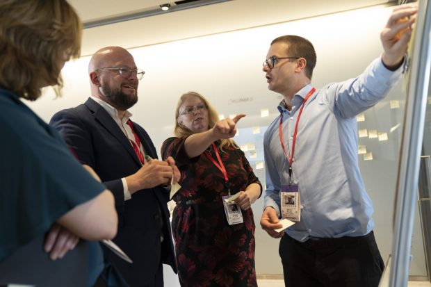 Sam Smith, Theo Blackwell, Sandra Taylor and Mikko Rusama stood around a flipchart, mapping out the challenges faced within their roles. Image courtesy of David Levenson.