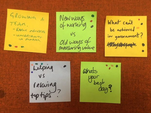 Discussion topics on post-it notes from a recent OneTeamGov meet-up, courtesy of @becpye. The post-its read: 'Growing a team', 'New ways of working versus old ways of measuring value', 'What can't be achieved in government?', 'Helping versus rescuing top tips?' and 'What's your best day?'