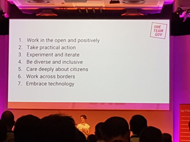 The OneTeamGov principles presented onstage by Kit Collingwood. They read: 1. Work in the open and positively. 2. Take practical action. 3. Experiment and iterate. 4. Be diverse and inclusive. 5. Care deeply about citizens. 6. Work across borders. 7. Embrace Technology. Image courtesy of @OneTeamGov